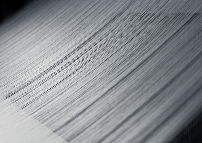 A processed yarn 1/3 the diameter of a single hair creates the world's lightest fabric.