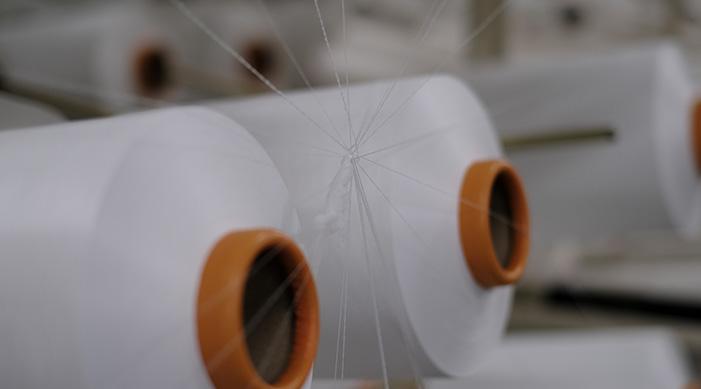 Yarn processing, weaving, knitting, sewing, and fashioning business